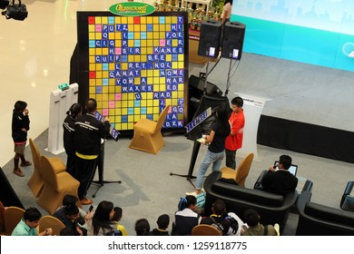 Rayong, Thailand - December 16th, 2018: A crossword or Scrabble word game is played on an oversized board for promotional purposes in Central Festival shopping center, Rayong, eastern Thailand.
