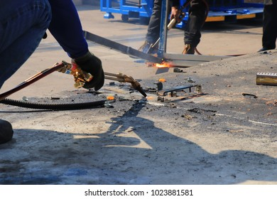 Rayong Thailand , February 13 - 2018 : Unidentifed Thai person technician cut steel to send to recycle in Thailand.