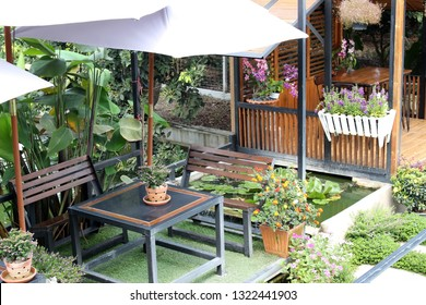 Rayong, Thailand - February 24th, 2019: Detail of modern outdoor furniture in a garden at a newly built cafe in the Khao Yai Da district, an area which caters for tourists during the fruit season.