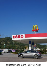 RAYONG, THAILAND - JANUARY 02 , 2016: McDonald's Logo thru drive restaurant in esso gas station highway road number36 on Dec 02, 2016 in Rayong , Thailand