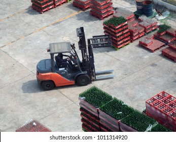 Rayong, Thailand - January 27th, 2018: A Toyota Forklift truck works around stacked up crates of empty Coca-Cola and Sprite bottles at a bottling facility in Rayong, eastern Thailand.