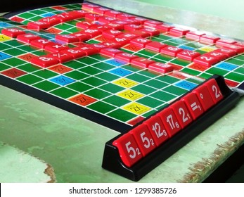 Rayong, Thailand - January 4th, 2019: Close up of a board where a game of the mathematics version of the famous Scrabble game popular in Asia is being played by creating sums as opposed to words.