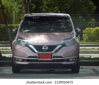 Rayong, Thailand - July 21st, 2018: Front view of a Nissan Note eco-car with red number plate signifying its a new car awaiting completed registration.