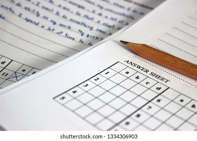 Rayong, Thailand - March 10th, 2019: A blank exam paper lies on top of a student's test paper already marked by a teacher at a school in eastern Thailand.