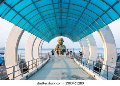 Rayong, Thailand - March 31, 2019: View of entrance pier gate to Samed Island with the Pisue Samutr sculpture or a female yak who can transmute herself into a beautiful girl in Rayong, Thailand.