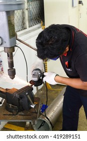 Rayong - Thailand , MAY 12 - 2016 : Unidentified worker use grinder machine grinding steel in manufacturing , THAILAND