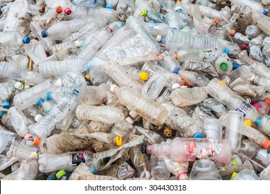 RAYONG, THAILAND - MAY 29, 2014 : Plastic bottles lie in a heap at an undisclosed recycling facility circa 2014 in Rayong. The plastic is gathered to be recycled.