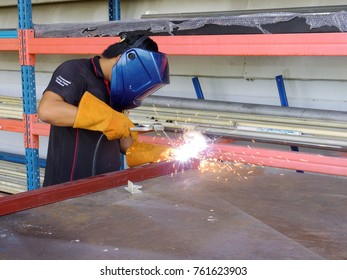 Rayong Thailand , Nov.24 - 2017 : Unidentified worker welding steel for fabrication in factory workshop.
