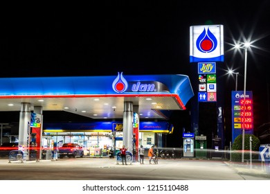 Rayong, Thailand - October 21, 2018: PTT gas station at night. PTT Public Company Limited is the biggest petrochemical company in Thailand. PTT  is a Thai state-owned SET-listed oil and gas company