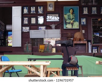 Rayong, Thailand - October 6th, 2018: A tourist sits in the interior of a museum of local heritage housed in a restored property on Yomjinda Road in the old town area of Rayong city.
