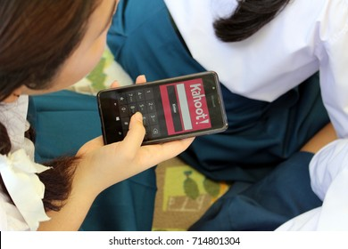 """Rayong, Thailand - September 7th, 2017: A Thai high school school girl in class plays """"Kahoot!"""", an online game based learning platform used as educational technology, Rayong, eastern Thailand."""