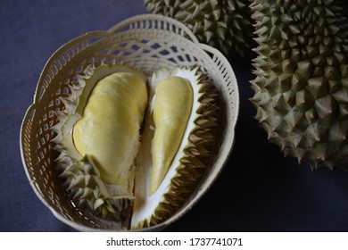 Rayong,Thailand - SEP 25, 2018:Fresh durian fruit placed on a  wicker basket. Durian the king of fruits The yellow color.Ripe durian tropical fruit summer for sweet dessert or snack in Thailand.King o