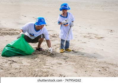 Rayong,Thailand: September 15 2012. Unidentified People cleaning up the coast in The International Coast Clean up 2012 on September 15 2012