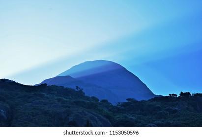 """Rays of Hope across Agasthyamala Peak, Kerala - Morning view"""