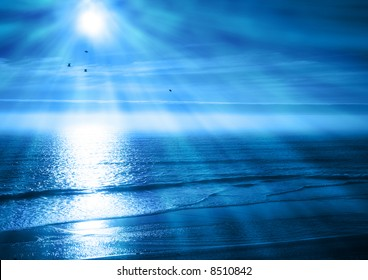 Rays of Light Beam Down on a Blue Ocean Sunset