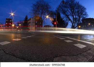 rays of light, car lights in the street, urban landscape at twilight