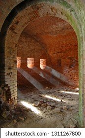 Rays of light hitting dusty floor of an abandoned casemate in 19th century fortress. Daugavpils, Latvia.