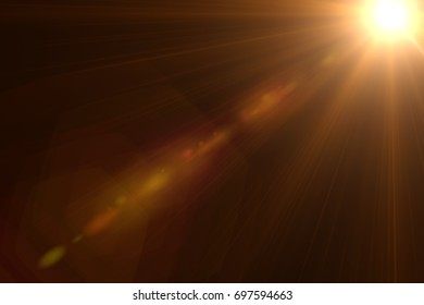 Rays of light & lens flare effect isolated on black background for overlay design