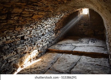 Rays of light shining into the old cellar