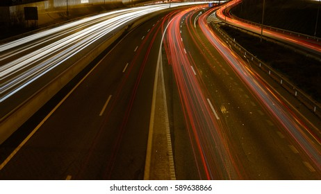 Rays of lights, car lights on a road, at night