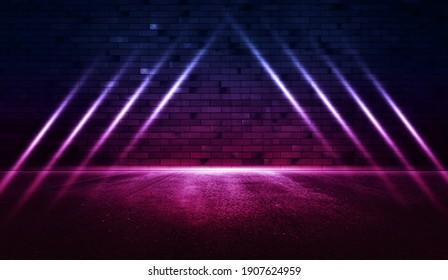 Rays neon light on neon brick wall with wet asphalt. Empty scene.