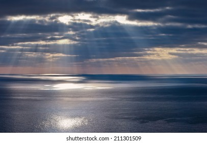 Rays of a sun above a sea