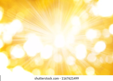 The rays of the sun on golden background