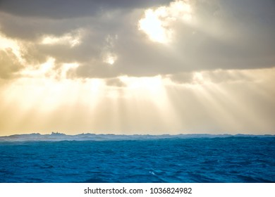 The rays of the sun through the clouds over the Atlantic Ocean. Punta Cana beach, Dominican Republic