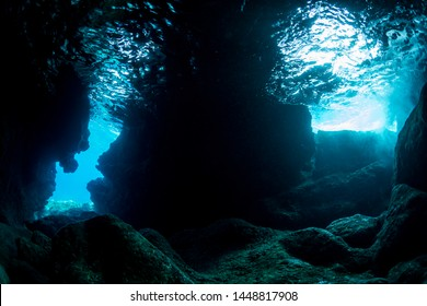 Rays of sunlight into the underwater cave