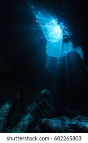Rays of sunlight shining into the cave, underwater view