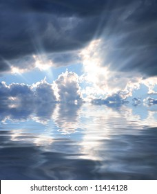 Rays of Sunshine Beaming through the Clouds Reflecting in Water