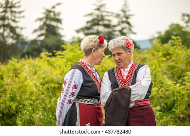 RAZHENA, BULGARIA - MAY 22, 2016 - Rose picking ritual in Razhena village. People dressed up in a traditional folklore costumes sing and dance for health and succesful harvest of the Bulgarian Roses.