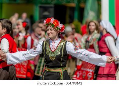 "RAZLOG, BULGARIA - APRIL 13, 2015: Female Bulgarian folklore dancer during the traditional folklore festival ""1000 national costumes"""