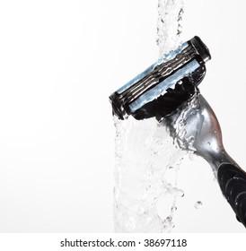 razor close-up with water splash isolated on grey