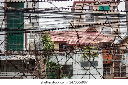 Razor wire fence of the Tuol Sleng Genocide Museum in Phnom Penh, Cambodia  The site is a former secondary school which was used as Security Prison 21 (S-21) by the Khmer Rouge regime.