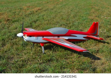 RC model airplane lands on the grass field