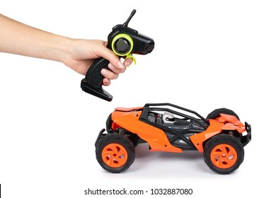 RC model rally, off road buggy with remote control in hand. Isolated on white background, joy and fun sport.