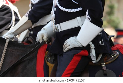 rcmp officers in military gear sitting on horses during an outdoor parade