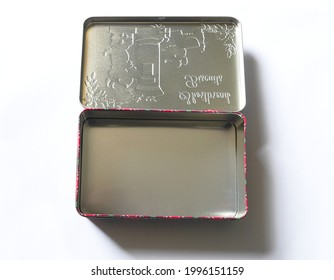 RCT, UK, June 24th, 2021 :  Empty tin box that once contained Christmas biscuits with Yuletide tartan edge pattern.