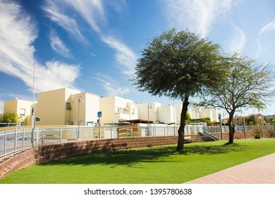 reach city street ecology landscaping view with green grass and trees, white buildings educational institution school and collage