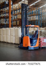 Reach trucks for perfect load control, material handling happens smooth and precisely in large warehouse.