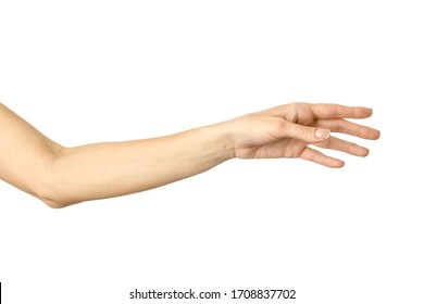Reaching hand. Woman hand with french manicure gesturing isolated on white background. Part of series