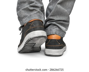 reaching leg men in gray jeans and street shoes isolated on white background