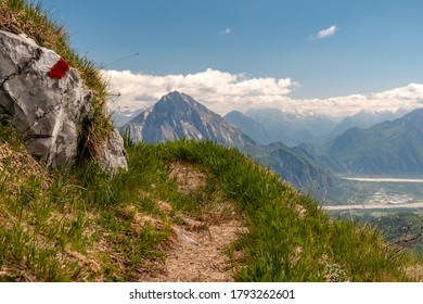 Reaching the top of a mountain in the Carnic Alps, Friuli-Venezia Giulia, Italy