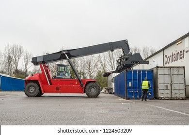 Reach-Stacker carrying a yellow Container