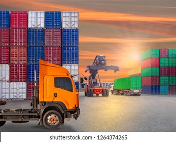 Reachstacker is moving full loaded containers at industrial port and container yard  to truck for  delivery to customers.