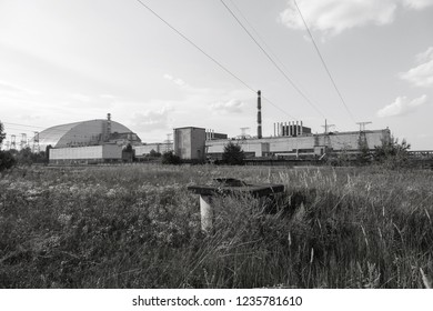 Reactor 4 at the Chernobyl nuclear power plant with a new confinement. Global atomic disaster. Chernobyl Exclusion Zone. Pripyat in the area of ​​the sarcophagus over a blasted nuclear reactor