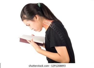 ืwoman read a book feel strain . neck bones pain
