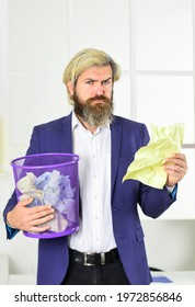 read the info. businessman hold trashcan. man in office look for lost note in paper bin. crumpled paper in wastepaper basket. man read piece of paper. office worker digging in garbage bin