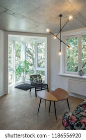 Reading area in studio apartments. Rest zone in a modern apartment.  Concrete.